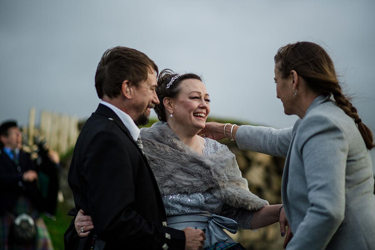 Celebrant Davina McCluskie hugging bride during wedding ceremony of bride and groom on Skye