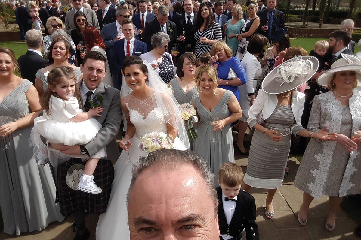 Celebrant Martin Turner selfie with wedding guests at a ceremony