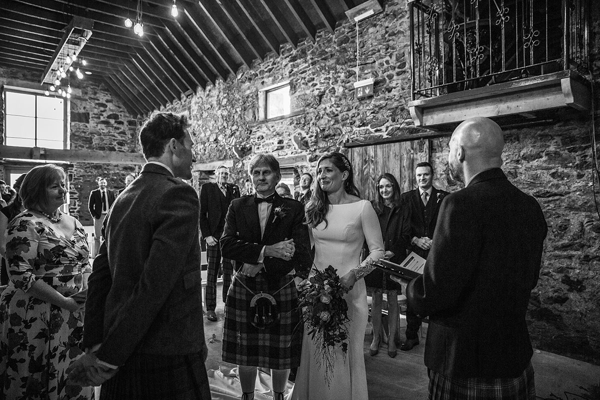 bride being given away at top of aisle at Cardney Steading wedding ceremony