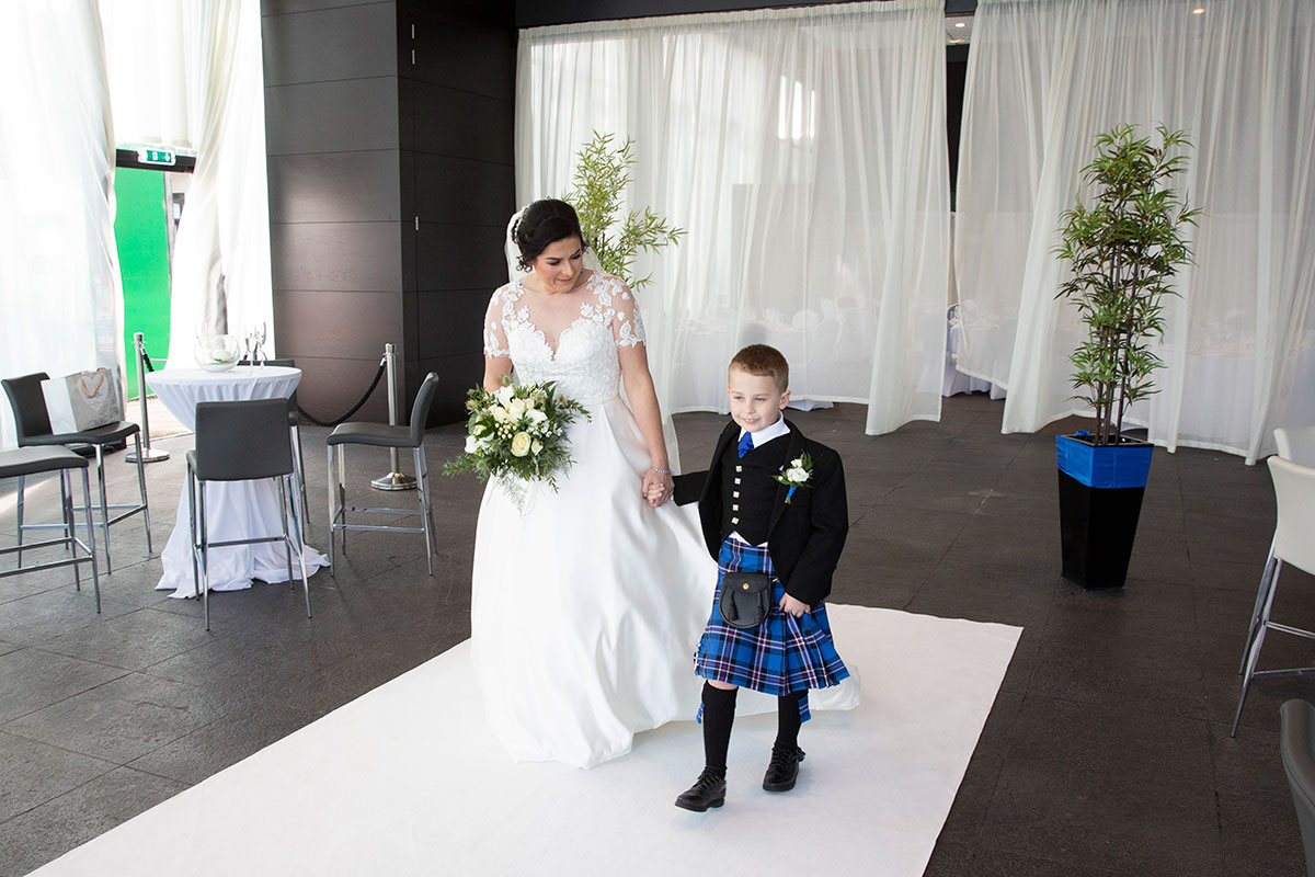 bride being given away by son at wedding at The Shore Loch Lomond