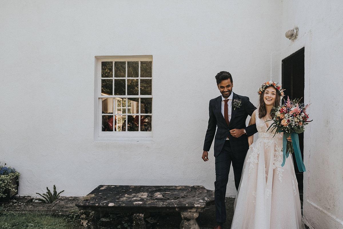 bride and groom laughing leaving Clachan Kirk in Kintyre