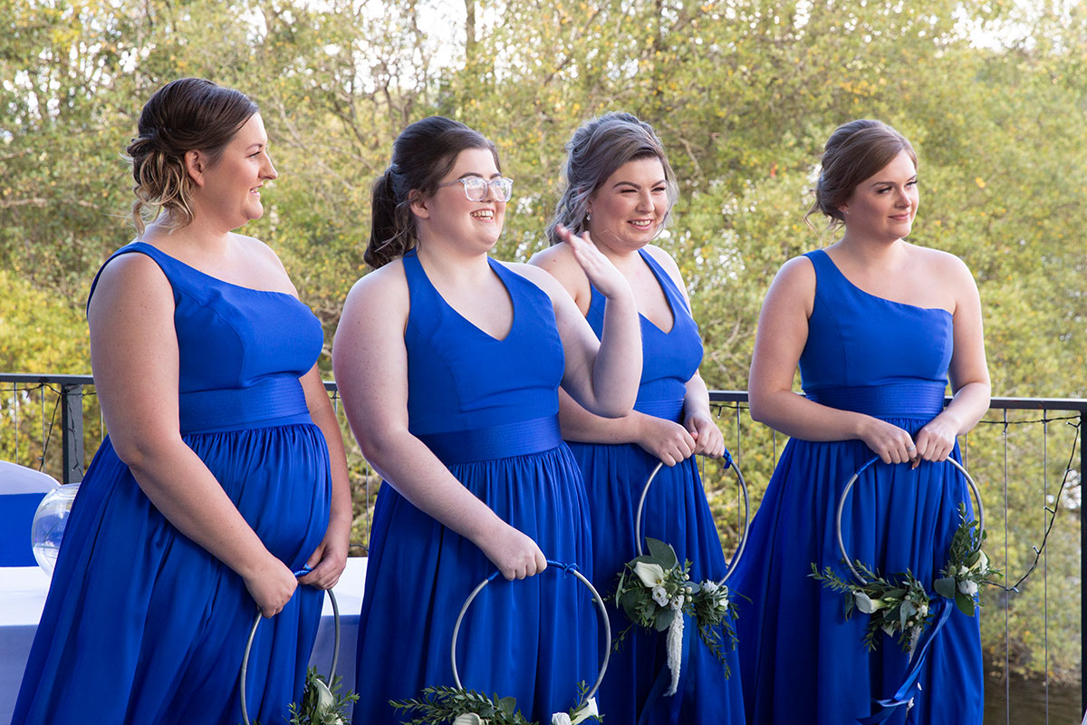 four bridesmaids wearing royal blue dresses
