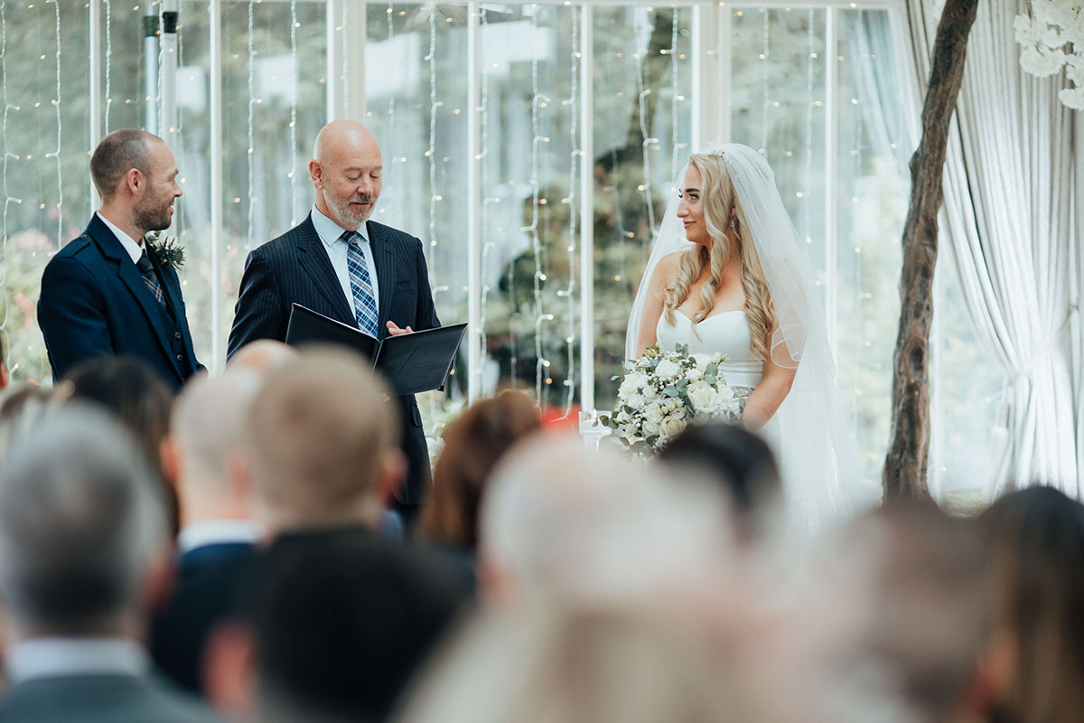 celebrant Tim Maguire leads wedding ceremony at Carlowrie Castle