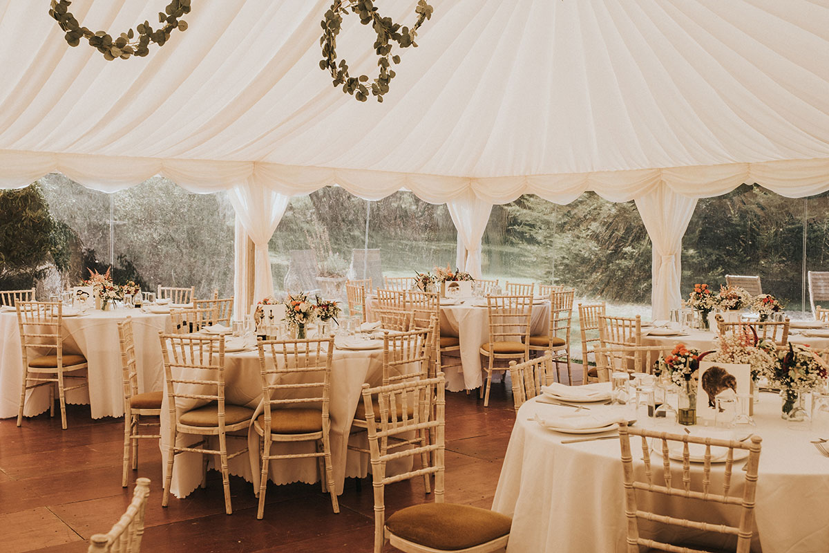 marquee wedding set up with tables and chiavari chairs at Balinakill Country House