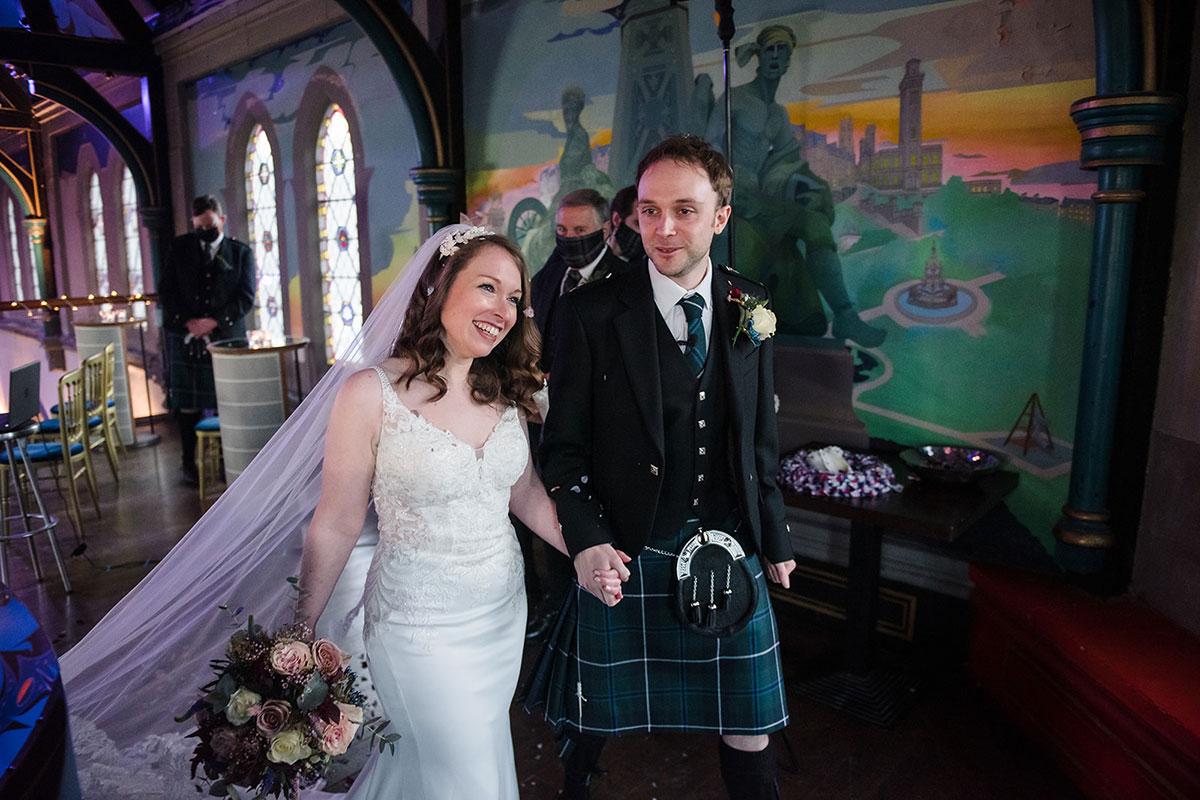 bride and groom smiling on mezzanine of Oran Mor