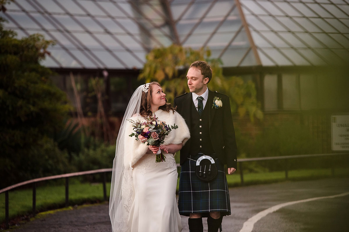 bride and groom walking in Botanic Gardens in Glasgow