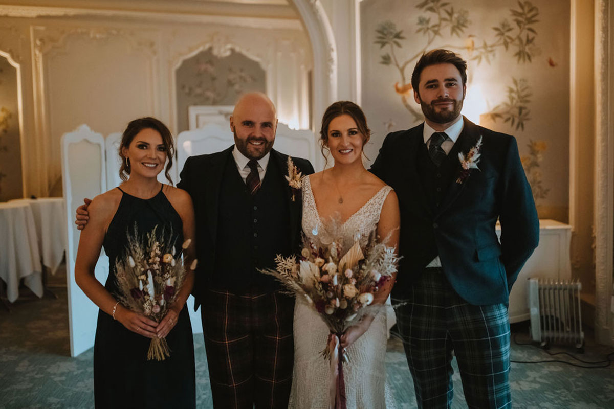 bride and groom with best man and bridesmaid at Waldorf Astoria Caledonian Edinburgh hotel