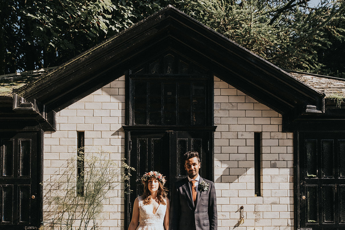 bride and groom outside black and white building in the sun at Balinakill Country House
