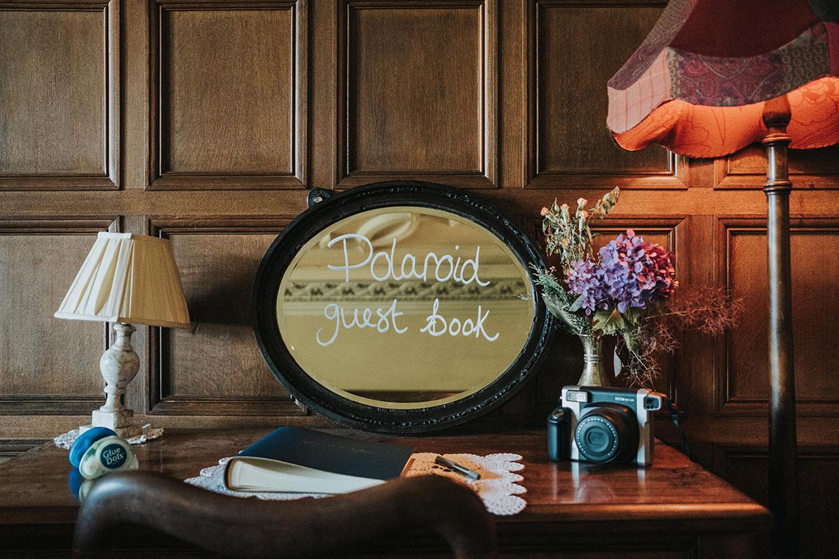 Polaroid guest book sign drawn on mirror at wedding at Balinakill Country House