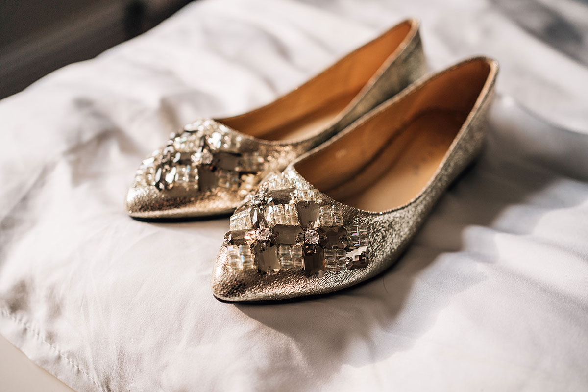flat gold pointed toe wedding shoes with jewels on front