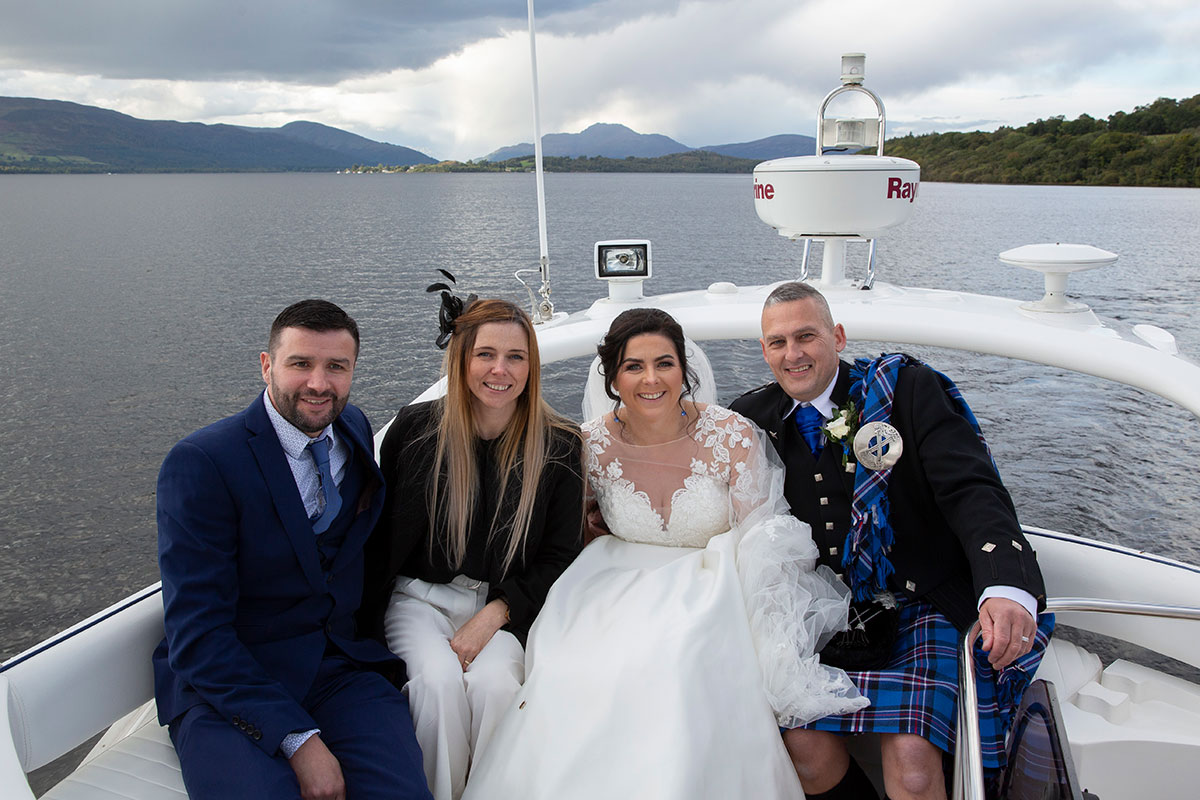 bride, groom and two guests on Beau Jangles boat on Loch Lomond