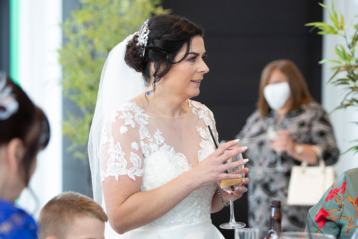 bride holding wine glass