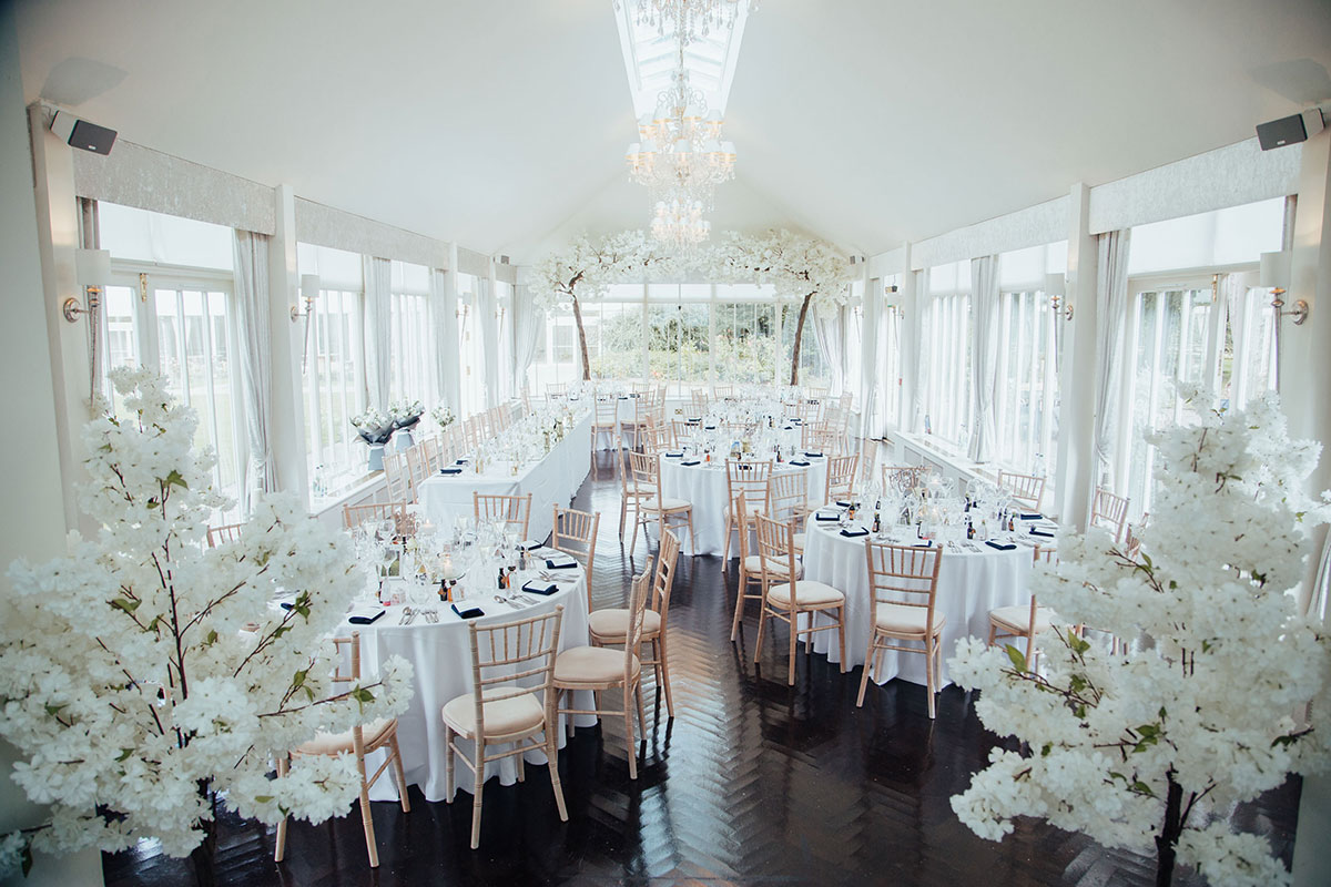 wedding tables and chairs at reception at Carlowrie Castle decorated by Quate and Co