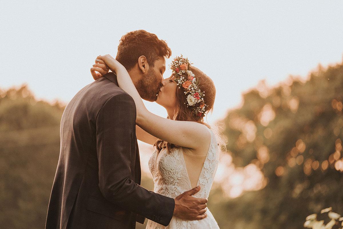 bride and groom kissing at sunset at Balinakill Country House