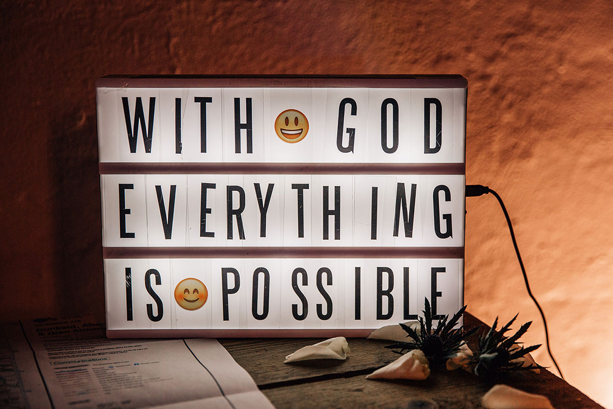 With God Everything is Possible cinema light box at wedding