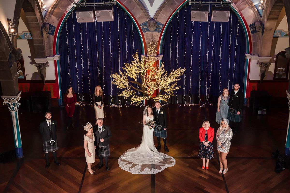 socially distanced family wedding portrait at Oran Mor in Glasgow