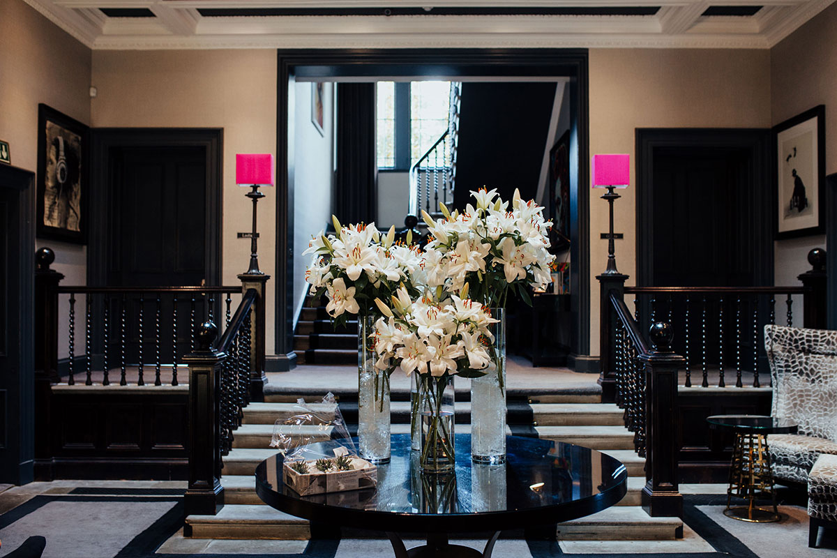 foyer at Carlowrie Castle with large lily floral arrangement on table
