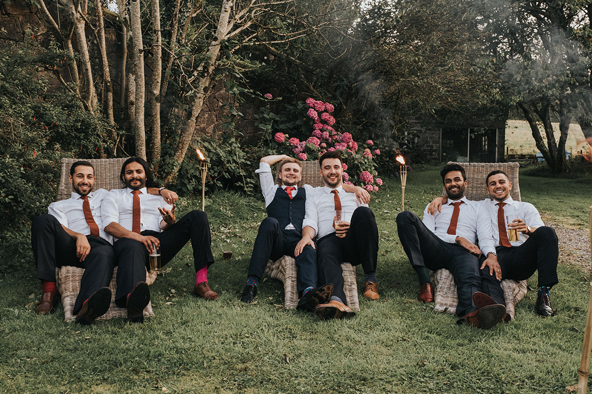 six male guests relaxing on chairs in garden at Balinakill Country House
