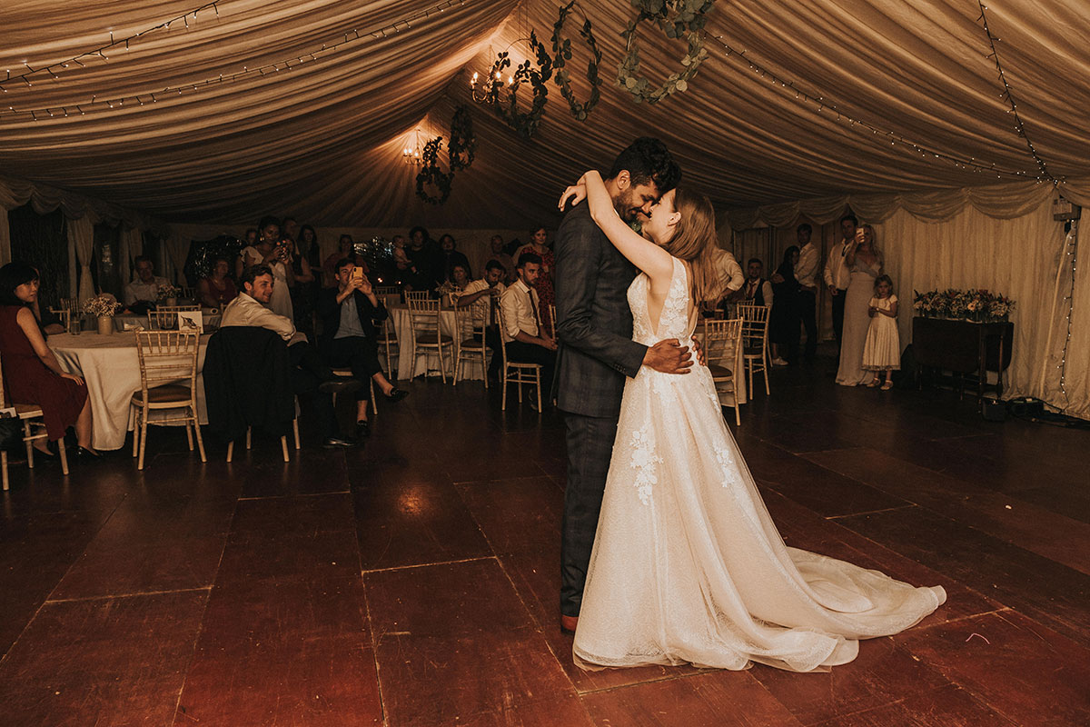 bride and groom during first dance watched on by guests at Balinakill Country House