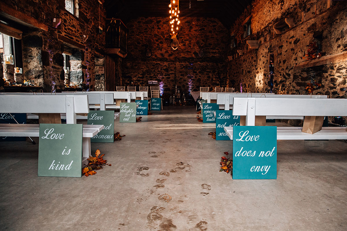 Cardney Steading set for a wedding ceremony with colourful Love placards