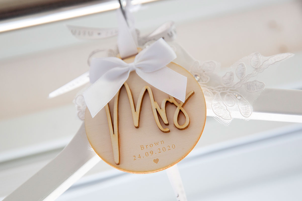 Mrs wooden wedding decoration tied with white ribbon