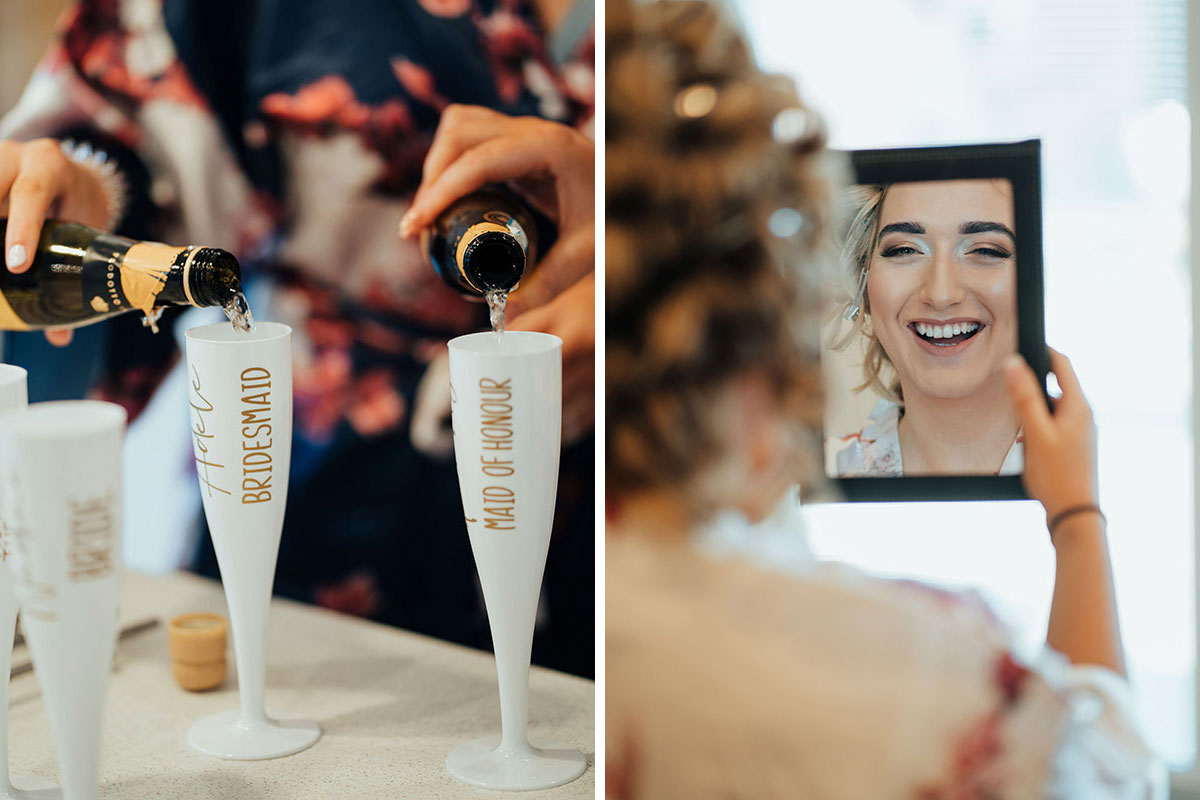 mini proscecco bottles being poured into personalised white and gold bridesmaid and maid of honour champagne flute and bride smiling into mirror on wedding morning
