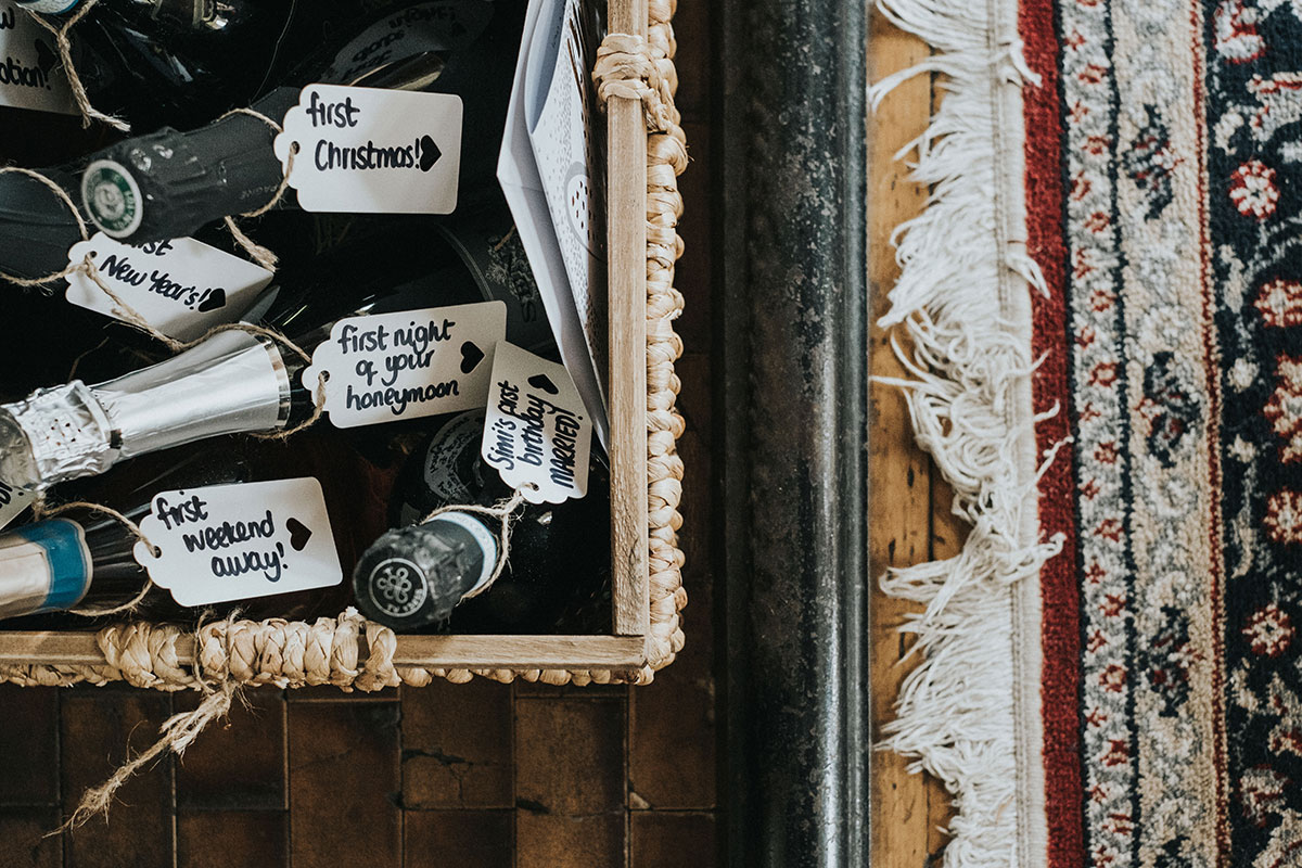 wedding prosecco in basket with tags for first anniversary and first christmas