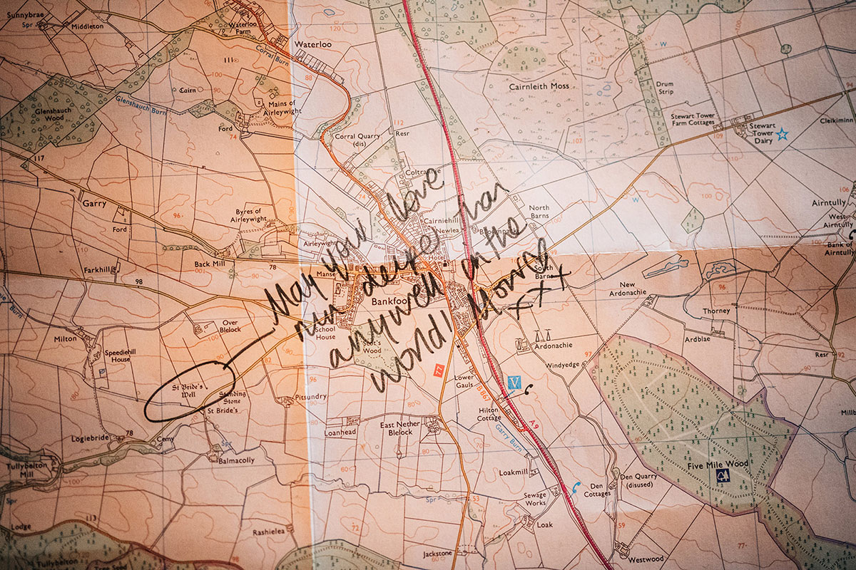 hand written message on Ordnance Survey map used as guest book at wedding