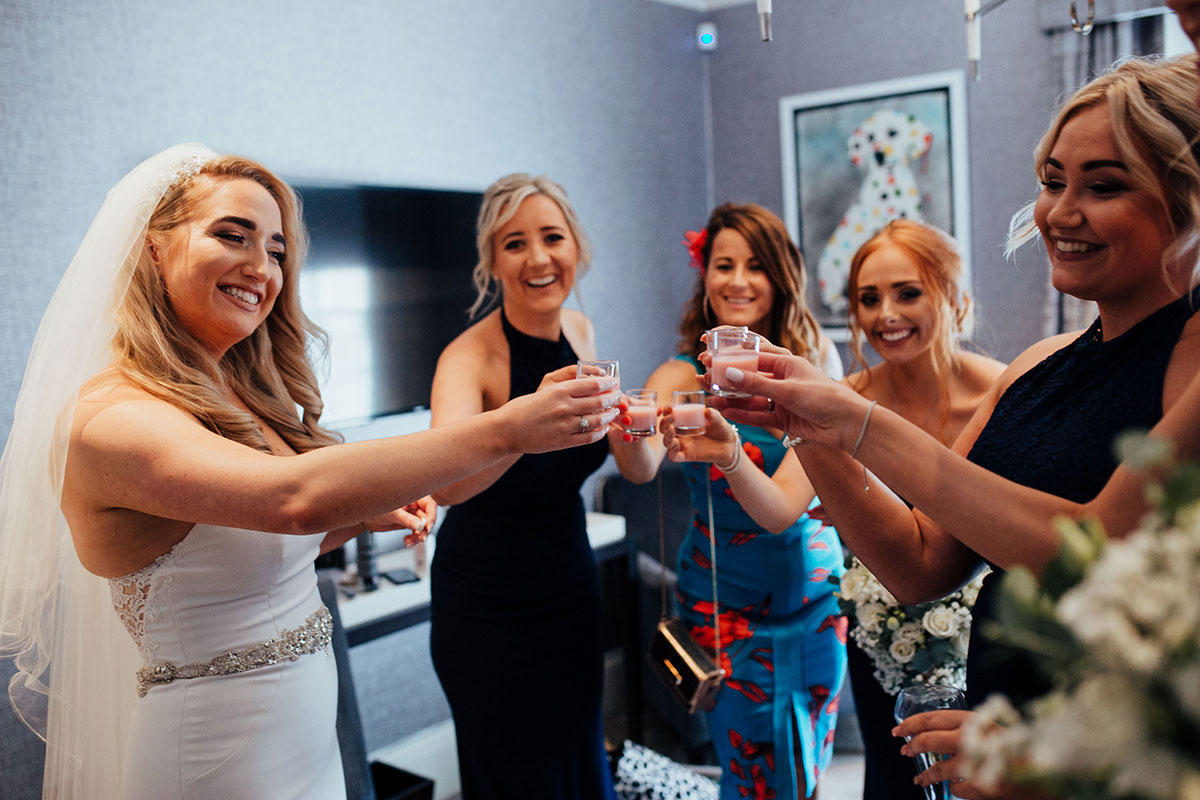 bride and four bridesmaids toasting with shots of Tequila Rose