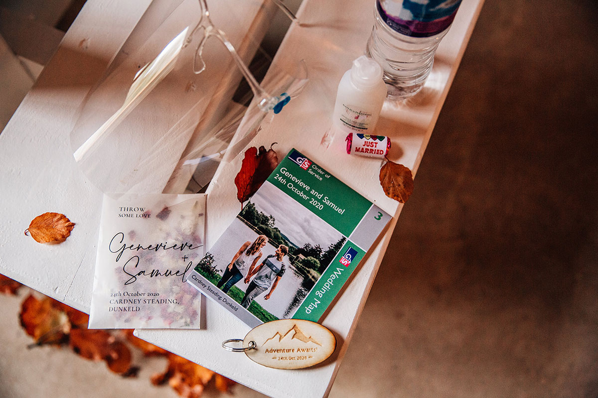 personalised Ordnance Survey wedding order of service with personalised confetti paper bag and bottle of hand sanitiser