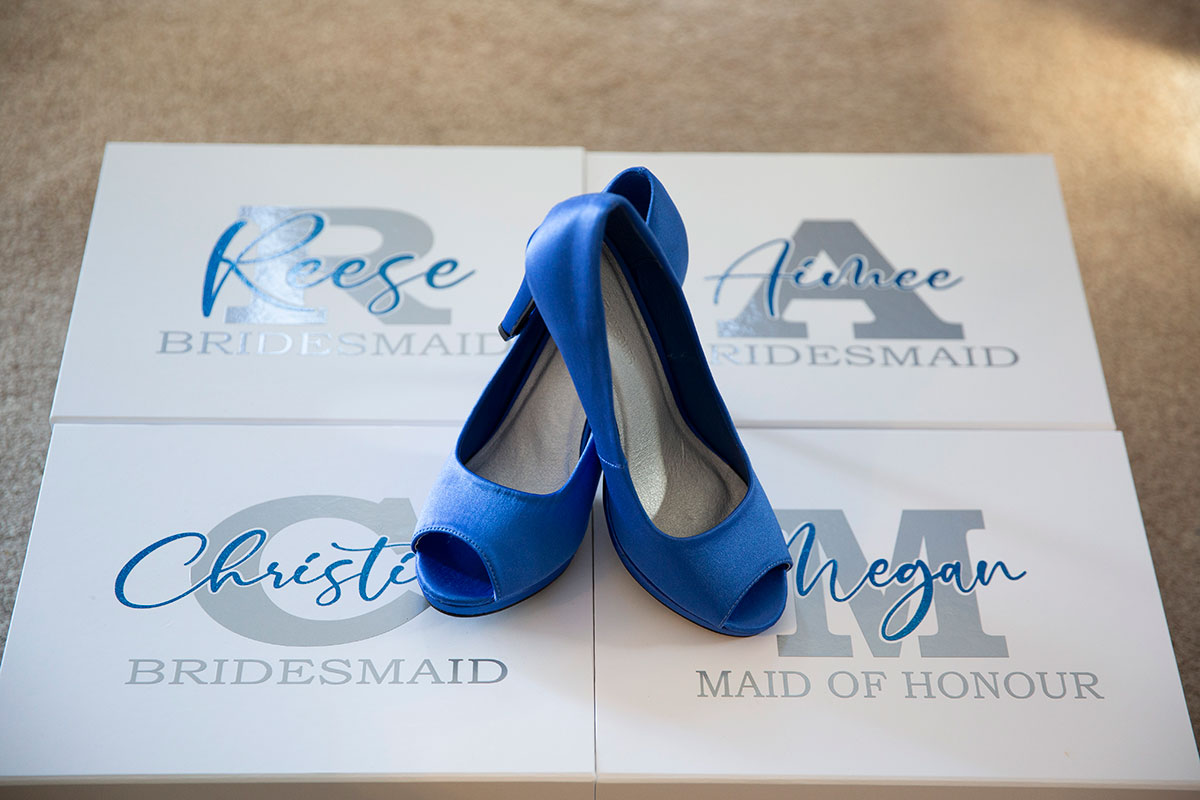 personalised bridesmaids shoeboxes with blue peep-toe shoes