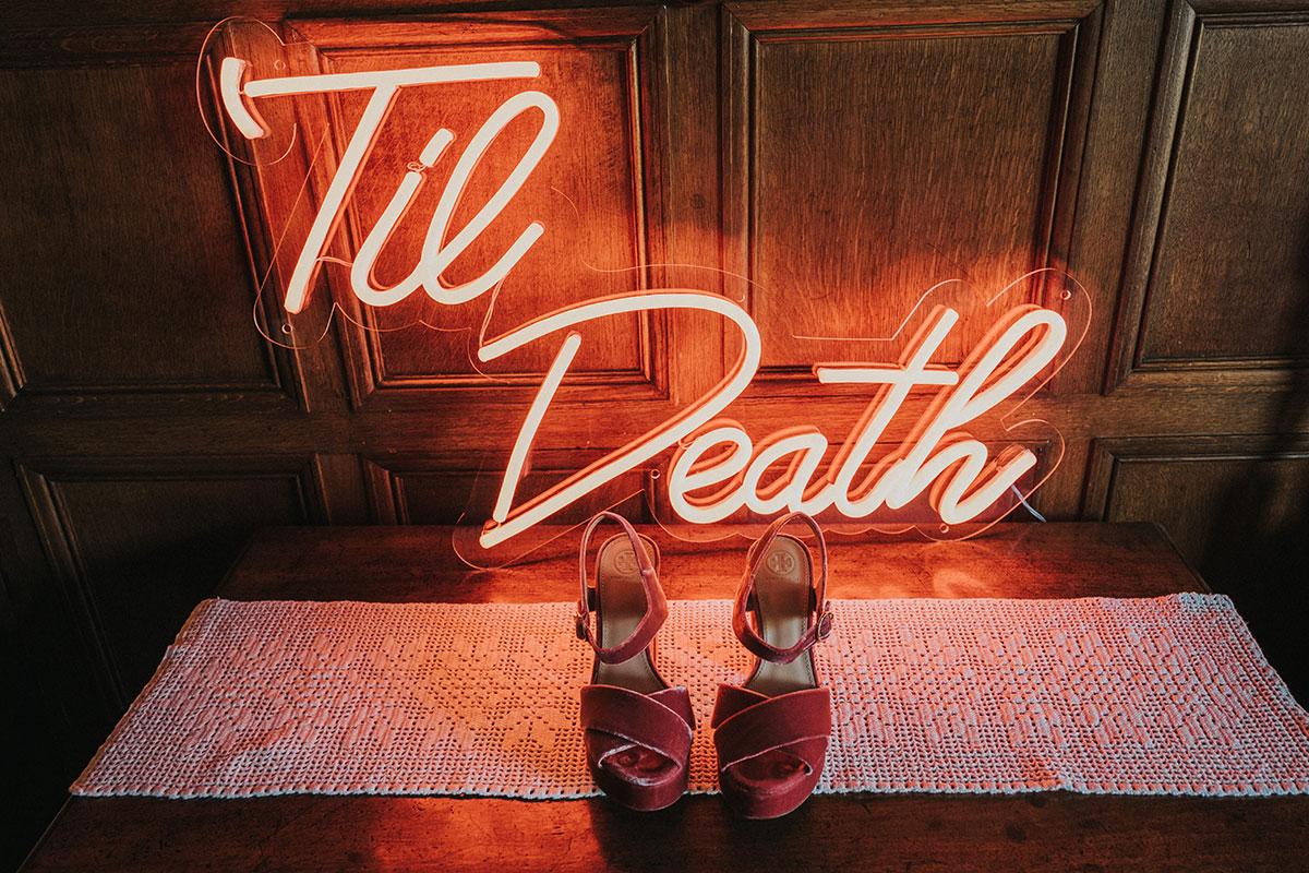 Til Death neon wedding sign and pink velvet shoes