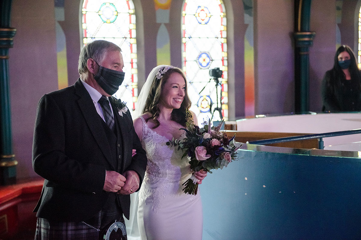 bride being given away by dad during wedding ceremony on mezzanine at Oran Mor