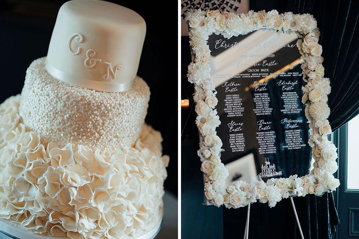 white ruffle wedding cake and mirrored white rose table seating plan at wedding