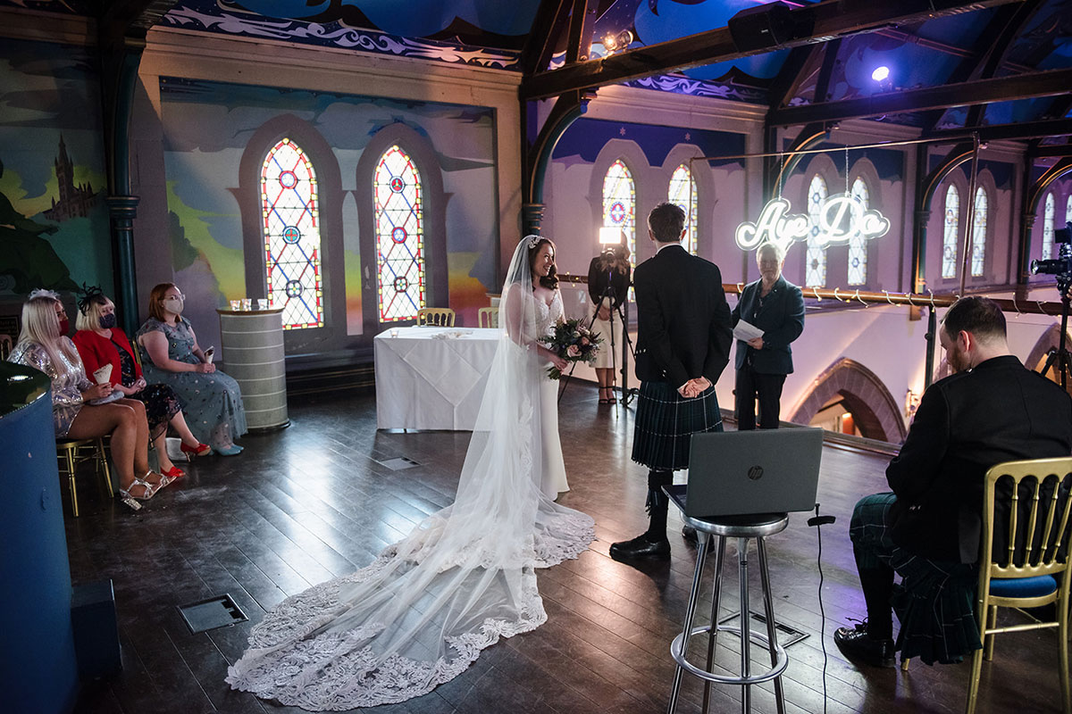 socially distance covid restricted wedding ceremony on mezzanine at Oran Mor in Glasgow