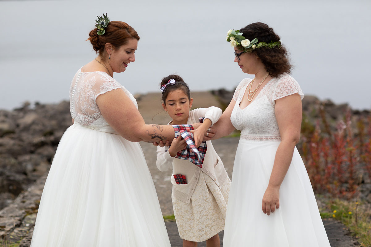 young girl performing hand fasting at lesbian wedding at Loch Turret Reservoir