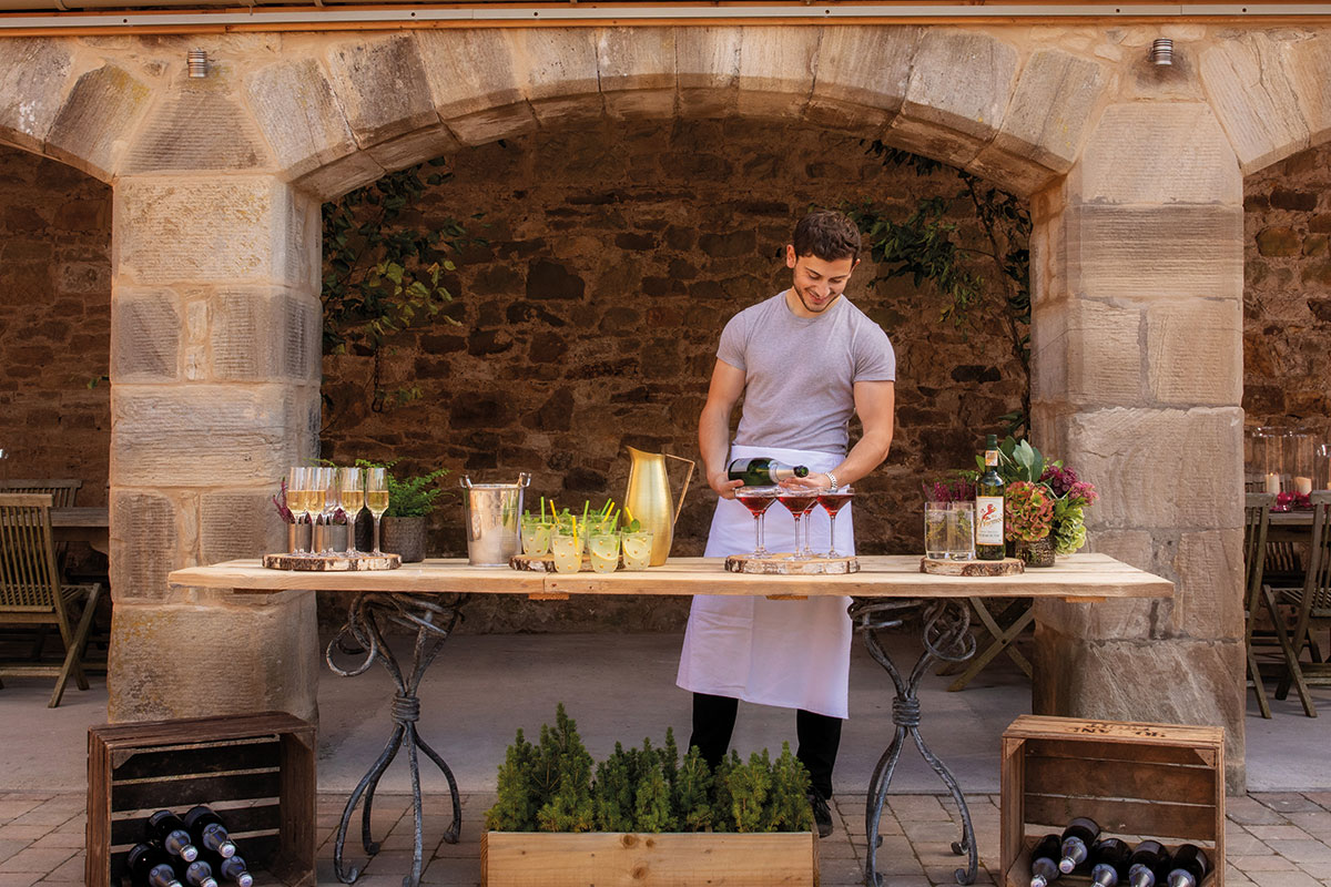 Rosebery Steading courtyard with chef preparing food outdoors on table