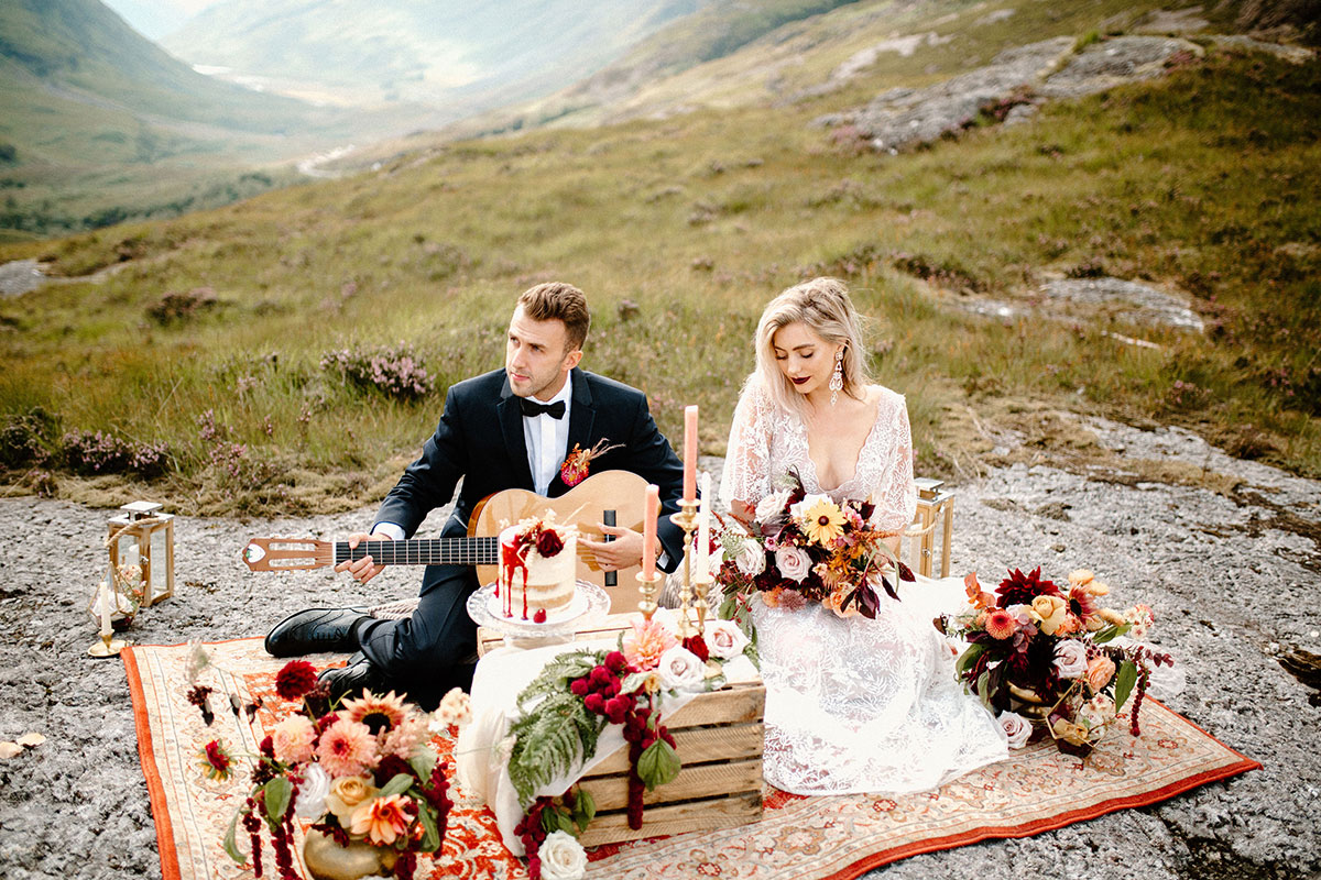bride and groom having a wild picnic in Glen Coe