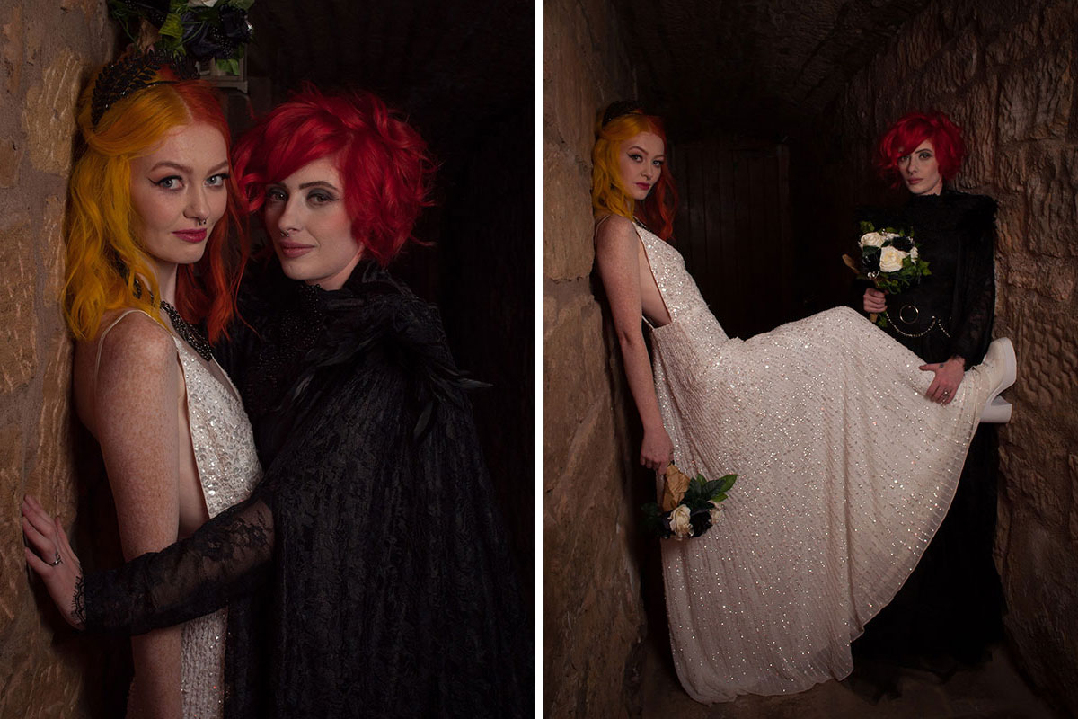 two brides with brightly coloured hair and nose rings posing in dark alleyway McDonalds Halloween wedding Scotland
