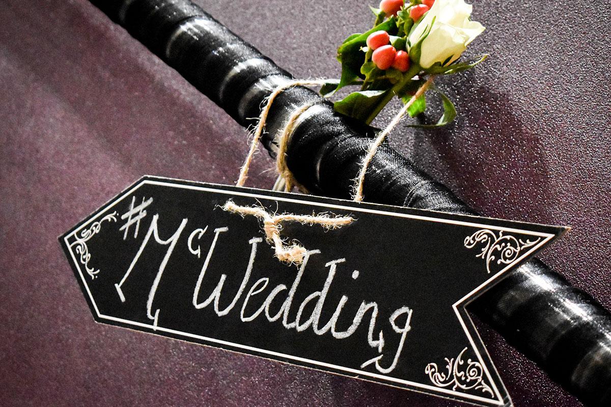 McWedding black arrow sign with flowers