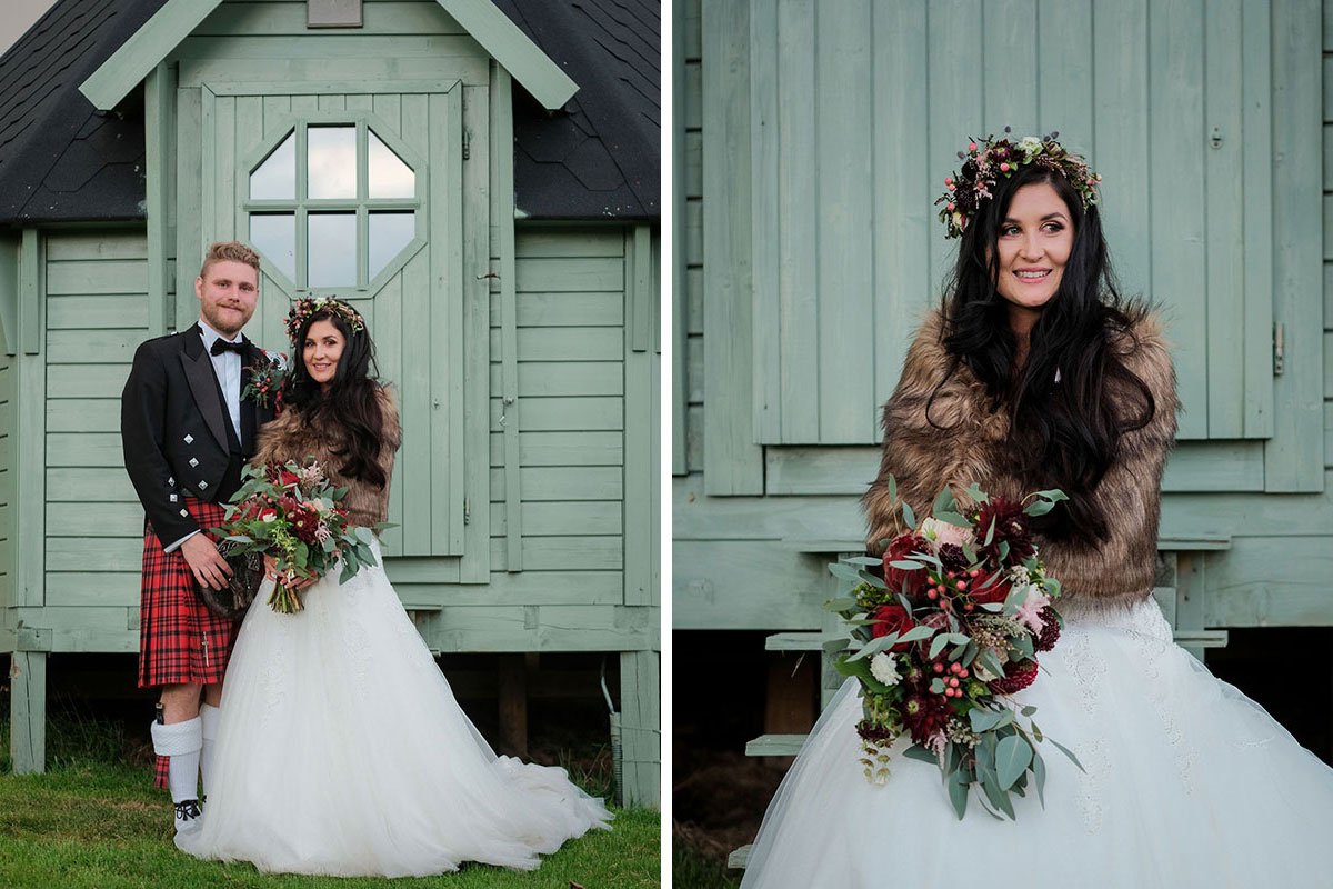 bride wearing faux fur stole with groom wearing red kilt at South Barlogan Farm wedding venue standing outside green wooden glamping pod