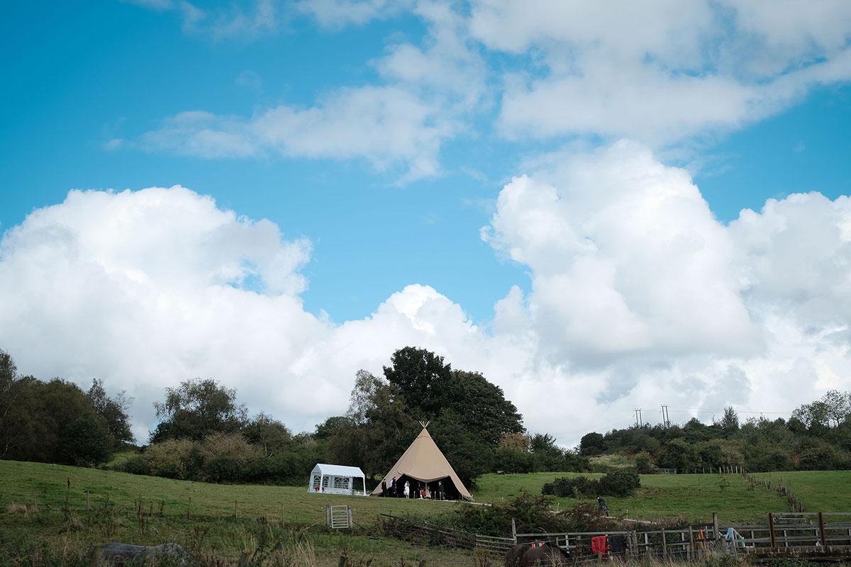 tipi wedding set up in field by Below Canvas at South Barlogan Farm