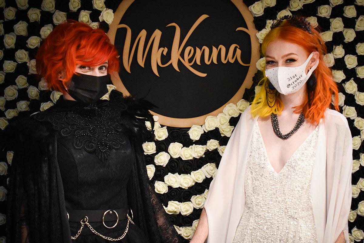 two brides wearing masks at Halloween McDonalds wedding