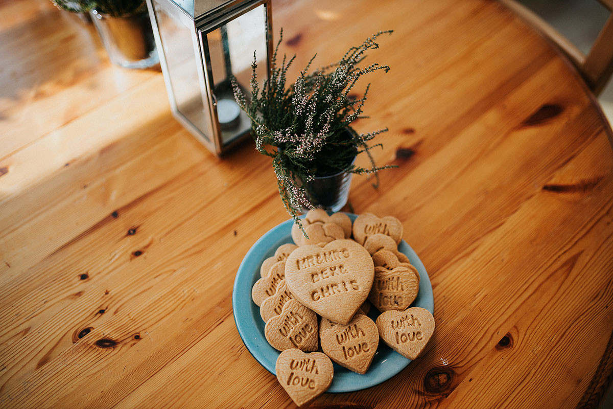 personalised wedding shortbread biscuits on blue plate on wooden table