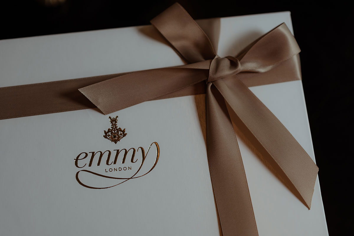 Emmy London bridal shoe box tied with gold ribbon bow