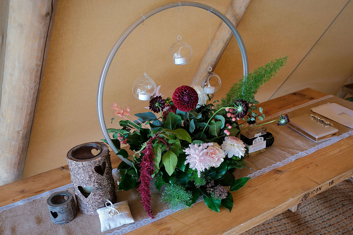 pink and dark red flower hoop with hanging glass tealight baubles by Posies and Pots