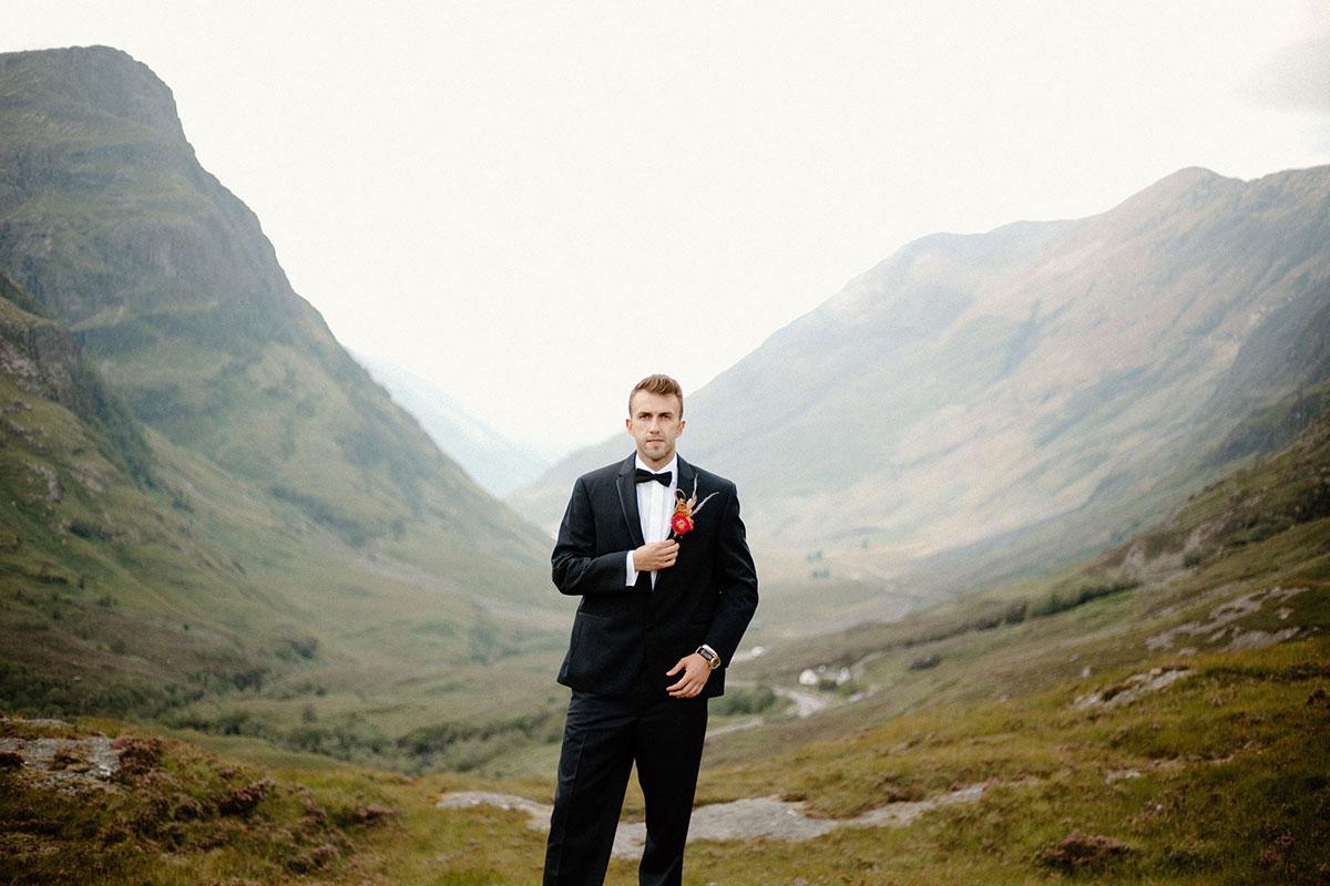 groom wearing black suit by Bowdens in Glen Coe