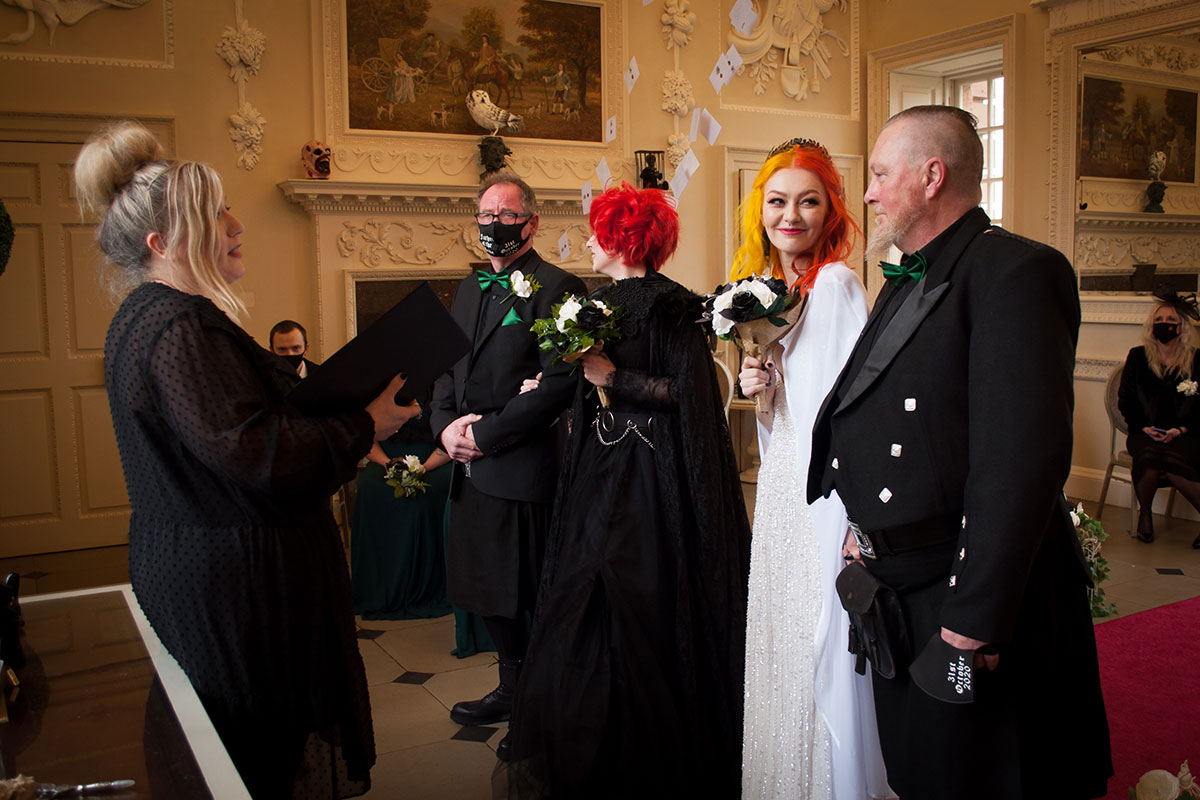two brides at top aisle with fathers at Halloween wedding ceremony at Chatelherault with celebrant leading ceremony