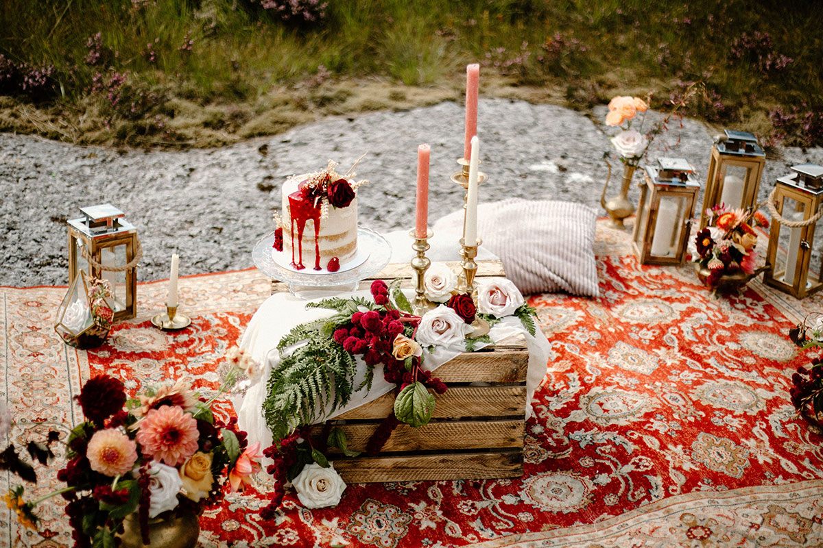 wild picnic wedding set up on Persian rug in Glen Coe