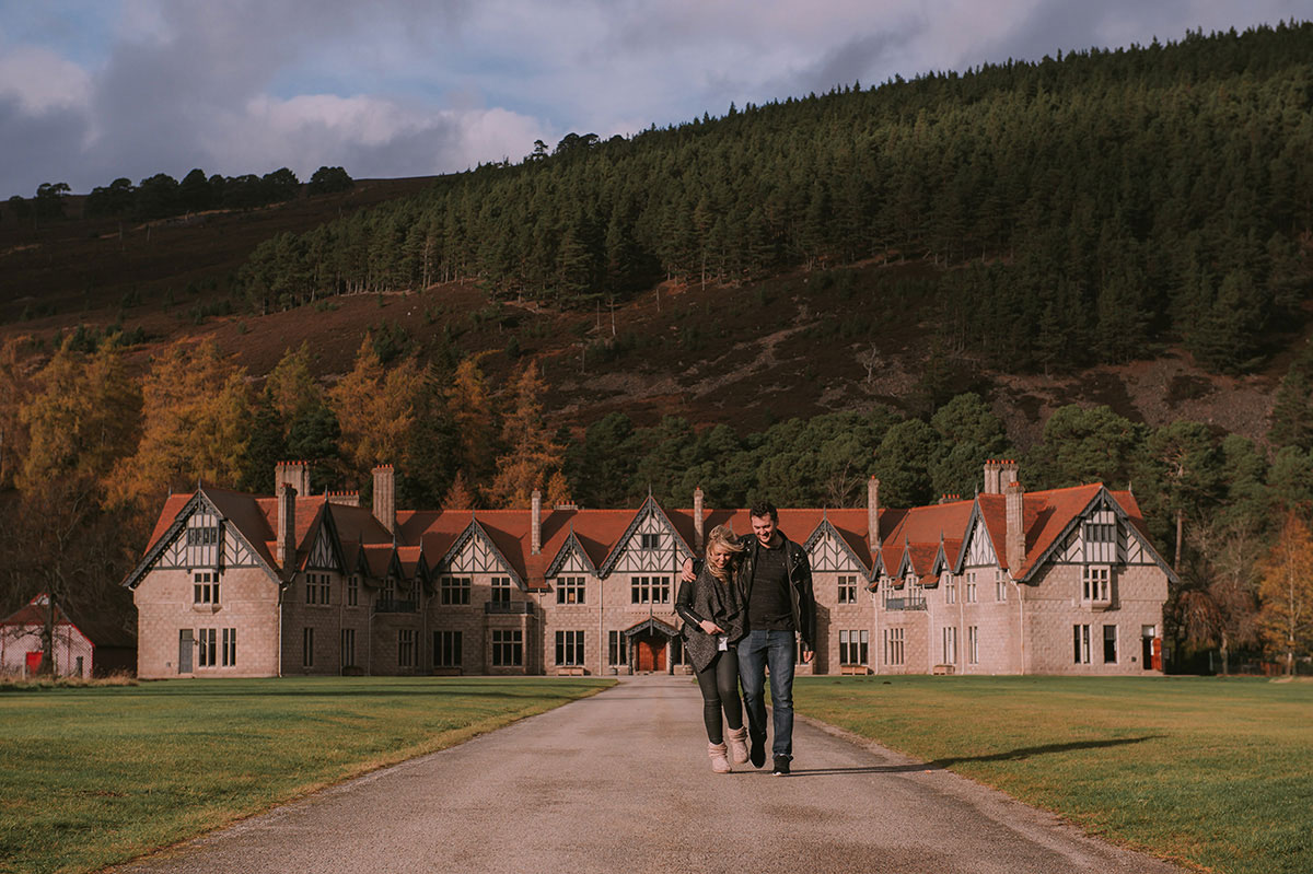 man and woman walking in grounds of Mar Lodge Aberdeenshire